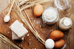 Fresh yeast and ingredients for baking on rustic kitchen table from above. Product for preparing pizza or bread. Fresh yeast and ingredients for baking on stock images