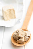 Fresh yeast on wooden spoon royalty free stock photo