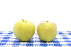 Fresh yellow apple fruit on blue tablemat Royalty Free Stock Photography