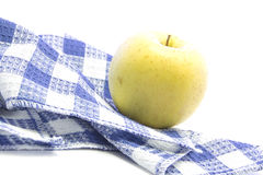 Fresh yellow apple healthy fruit on blue tablemat Royalty Free Stock Photography