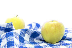 Fresh yellow apple healthy fruit on blue tablemat Stock Images