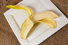 Fresh yellow bananas,wood,table,burlap cloth Royalty Free Stock Photos