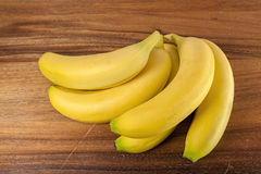 Fresh yellow bananas,wood,table Royalty Free Stock Photo