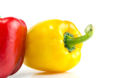 Fresh yellow  bell peppers on white background Stock Photos