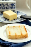 Fresh yellow butter on toast Stock Photos