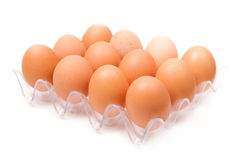 Fresh yellow chicken eggs in container Royalty Free Stock Image
