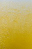 Fresh yellow fruits juice background texture with foam. Orange water bubbles. Macro. Royalty Free Stock Photos