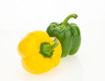 Fresh yellow and green bell peppers Stock Images