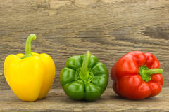 Fresh yellow, green and red bell peppers Royalty Free Stock Images