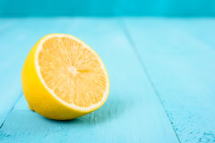 Fresh Yellow Lemon Slice On Turquoise Table Stock Image