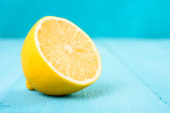 Fresh Yellow Lemon Slice On Turquoise Table stock photos