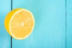 Fresh Yellow Lemon Slice On Turquoise Table Stock Photo