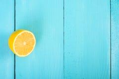 Fresh Yellow Lemon Slice On Turquoise Table Royalty Free Stock Photos