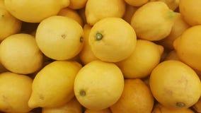 Fresh and yellow lemons Stock Images