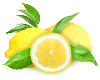 Fresh yellow lemons with green leaf Stock Photos