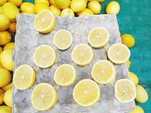 Fresh yellow lemons at the market - lemon cut in the middle Stock Photo