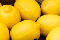 Fresh yellow lemons in street market Royalty Free Stock Images