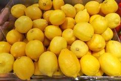 Fresh yellow lemons in the vegetables market Stock Photo
