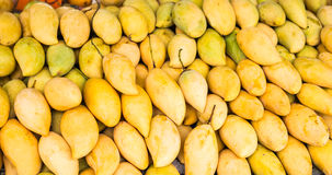 Fresh yellow mango. Fruit market with various colorful fresh fruits and vegetables Stock Photo