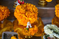 Fresh yellow Marigold floral garland arrangement with Crown flower and jasmine on golden color offering tray with pedestal Stock Images