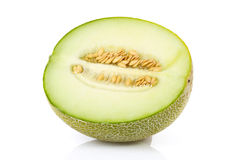 Fresh yellow melon in half over white background Royalty Free Stock Photo
