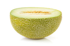 Fresh yellow melon in half over white background Stock Images