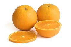 Fresh yellow oranges  on white. Background Stock Photos