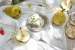 Fresh yellow Pears and cheese. Whole and a half pear on white Royalty Free Stock Photo