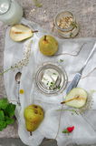 Fresh yellow Pears and cheese. Whole and a half pear on white Royalty Free Stock Photography