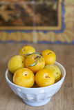 Fresh yellow plums in a bowl. Stock Photos