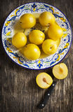 Fresh yellow plums in a plate. Stock Image