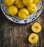 Fresh yellow plums in a plate. Stock Photo