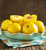 Fresh yellow plums in a plate. Stock Photography