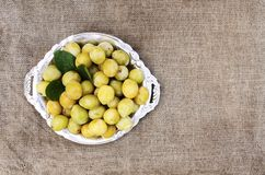 Fresh yellow plums. Ripe fruits on a rough burlap texture background royalty free stock image