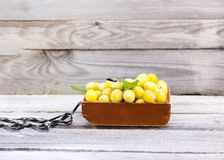 Fresh yellow plums. Ripe fruits in a wooden box stock photo
