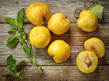 Fresh yellow plums. On wooden table, top view Stock Photography