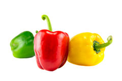 Fresh yellow, red and green bell peppers on white background Royalty Free Stock Photo