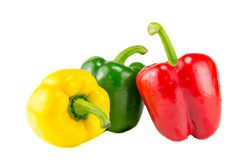 Fresh yellow, red and green bell peppers Stock Photo