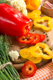 Fresh yellow and red pepper. On the wooden board Stock Images