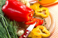 Fresh yellow and red pepper. On the wooden board Royalty Free Stock Images