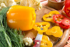 Fresh yellow and red pepper on the wooden board Stock Photo