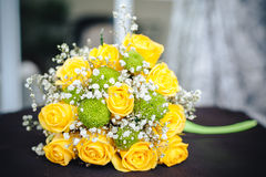 Fresh yellow roses with a checkered ribbon on Stock Images