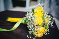 Fresh yellow roses with a checkered ribbon on Royalty Free Stock Photos