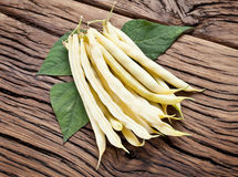 Fresh yellow string beans on the old wood. Royalty Free Stock Photography