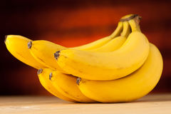 Fresh, yellow and sweet bananas on the table Royalty Free Stock Image
