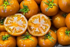 Fresh yellow tomatoes at the market. Close view royalty free stock photography