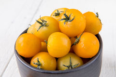 Fresh yellow tomatoes on white wooden table Stock Photography