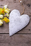 Fresh yellow tulips and daffodils flowers  and decorative heart Stock Photo