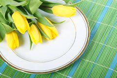 Tulips on placemats Royalty Free Stock Photography