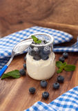 Fresh yogurt with blueberry and mint in a glass jar Royalty Free Stock Photo